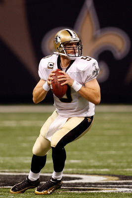 NEW ORLEANS - OCTOBER 18:  Drew Brees #9 of the New Orleans Saints throws a pass against the New York Giants at the Louisiana Superdome on October 18, 2009 in New Orleans, Louisiana.  The Saints defeated the Giants 48-27.  (Photo by Chris Graythen/Getty I