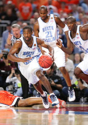 ST. LOUIS - APRIL 04:  Raymond Felton #2 handles the ball as teammate Jawad Williams #21 and Marvin Williams #24 of the North Carolina Tar Heels trail against behind Illinois Fighting Illini in the first half during the NCAA Men's National Championship ga