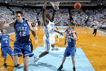 CHAPEL HILL, NC - MARCH 6:  Marvin Williams #24 of the North Carolina Tar Heels dunks the ball over Randolph Shavlik #42 and Lee Melchionni #13 of the Duke Blue Devils on March 6, 2005 at the Dean E. Smith Center in Chapel Hill, North Carolina. The Tar He