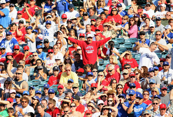 ANAHEIM, CA - JULY 03:  Angels and Dodgers fans react after a safe call at third on James Loney #7 of the Los Angeles Dodgers during the MLB game between the Los Angeles Dodgers and the Los Angeles Angels of Anaheim at Angel Stadium of Anaheim on July 3,