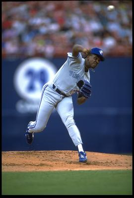 10 May 1992: JUAN GUZMAN OF THE TORONTO BLUE JAYS RELEASES A PITCH DURING THEIR GAME AGAINST THE ANGELS AT ANAHEIM STADIUM IN ANAHEIM, CALIFORNIA.