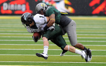 EUGENE, OR - SEPTEMBER 18: Rover Eddie Pleasant #11 of the Oregon Ducks tackles running back Cory McCaffery #1 of the Portland State Vikings in the second quarter of the game at Autzen Stadium on September 18, 2010 in Eugene, Oregon.  (Photo by Steve Dyke