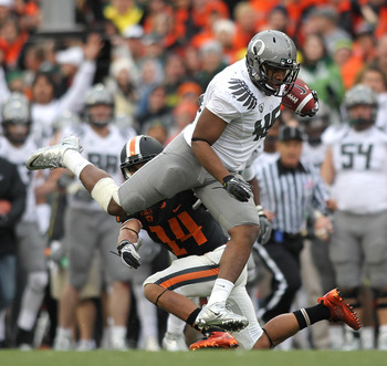CORVALLIS, OR - DECEMBER 04:  Terrell Turner #45 of the Oregon Ducks runs the ball on a fake punt play against Jordan Poyer #14 of the Oregon State Beavers during the 114th Civil War on December 4, 2010 at the Reser Stadium in Corvallis, Oregon.  (Photo b