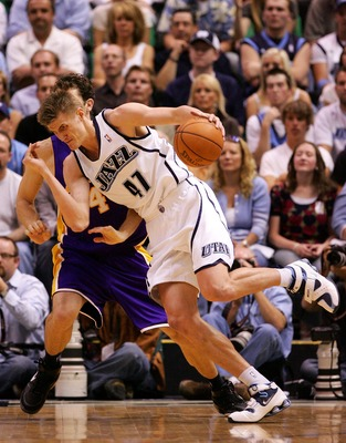 SALT LAKE CITY - MAY 11:  Andrei Kirilenko #47 of the Utah Jazz drives against Luke Walton #4 of the Los Angeles Lakers in Game Four of the Western Conference Semifinals during the 2008 NBA Playoffs on May 11, 2008 at Energy Solutions Arena in Salt Lake C