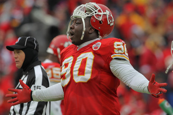 KANSAS CITY, MO - JANUARY 09:  Defensive tackle Shaun Smith #90 of the Kansas City Chiefs reacts after a play against the Baltimore Ravens during their 2011 AFC wild card playoff game at Arrowhead Stadium on January 9, 2011 in Kansas City, Missouri.  (Pho