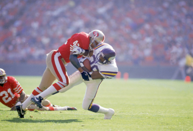 SAN FRANCISCO - OCTOBER 30:  Defenseman Ronnie Lott #42 of the San Francisco 49ers makes a tackle during a NFL game against the Minnesota Vikings at Candlestick Park on October 30, 1988 in San Francisco, California.  The Niners defeated the Vikings 24-21.