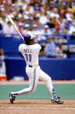 TORONTO - 1989:  George Bell #11 of the Toronto Blue Jays swings at a pitch during a 1989 game at Skydome in Toronto, Ontario, Canada. (Photo by Rick Stewart/Getty Images)