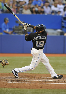 TORONTO, CANADA - JUNE 30:  Jose Bautista #19 of the Toronto Blue Jays bats during MLB interleague game action against the Toronto Blue Jays June 30, 2011 at Rogers Centre in Toronto, Ontario, Canada. (Photo by Brad White/Getty Images)
