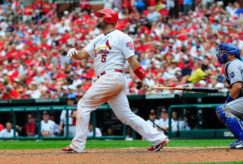 ST. LOUIS, MO - JUNE 19: Albert Pujols #5 of the St. Louis Cardinals follows through on a solo home run against the Kansas City Royals at Busch Stadium on June 19, 2011 in St. Louis, Missouri.  (Photo by Jeff Curry/Getty Images)