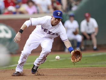 ARLINGTON, TX - JUNE 22:   Michael Young #10 of the Texas Rangers catches a ground ball against the Houston Astros at Rangers Ballpark in Arlington on June 22, 2011 in Arlington, Texas.  (Photo by Rick Yeatts/Getty Images)