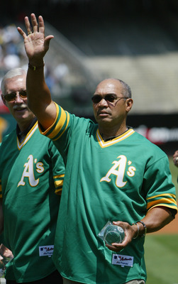 OAKLAND, CA - AUGUST 2:  Baseball hall of famer Reggie Jackson of the 1973 World Champion Oakland Athletics waves to the crowd during a ceremony before the game against the New York Yankees at the Network Associates Coliseum on August 2, 2003 in Oakland,