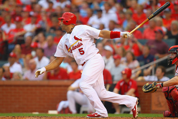 ST. LOUIS, MO - JULY 6: Albert Pujols #5 of the St. Louis Cardinals grounds out in his first at-bat after returning from the disabled list against the Cincinnati Reds at Busch Stadium on July 6, 2011 in St. Louis, Missouri.  (Photo by Dilip Vishwanat/Gett