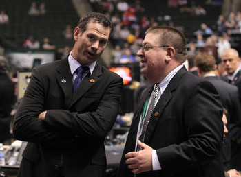 ST PAUL, MN - JUNE 24:  Special Assistant to the General Manager Craig Conroy and General Manager Jay Feaster share a conversation during day one of the 2011 NHL Entry Draft at Xcel Energy Center on June 24, 2011 in St Paul, Minnesota.  (Photo by Bruce Be