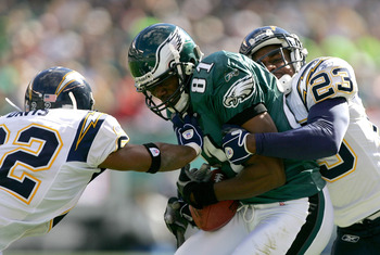PHILADELPHIA - OCTOBER 23:  Terrell Owens #81 of the Philadelphia Eagles is tackled by Sammy Davis #22 and Quentin Jammer #23 of San Diego Chargers on October 23, 2005 at Lincoln Financial Field in Philadelphia, Pennsylvania. The Eagles defeated the Charg