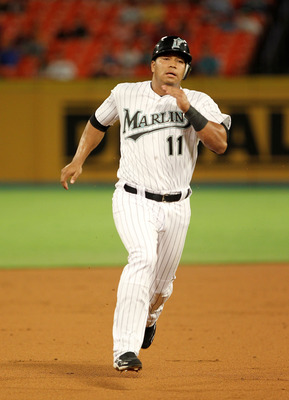 MIAMI GARDENS, FL - JUNE 20: Jose Lopez #11 of the Florida Marlins rounds second during a game against the Los Angeles Angels of Anaheim at Sun Life Stadium on June 20, 2011 in Miami Gardens, Florida.  (Photo by Mike Ehrmann/Getty Images)