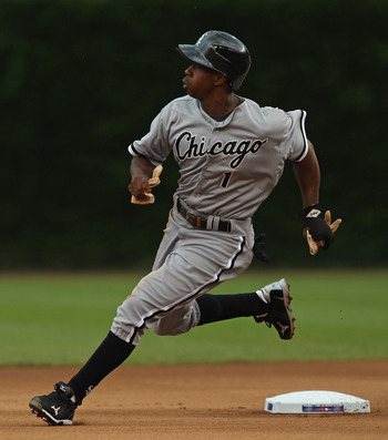 CHICAGO, IL - JULY 01:  Juan Pierre #1 of the Chicago White Sox runs past second base against the Chicago Cubs at Wrigley Field on July 1, 2011 in Chicago, Illinois. The White Sox defeated the Cubs 6-4.  (Photo by Jonathan Daniel/Getty Images)