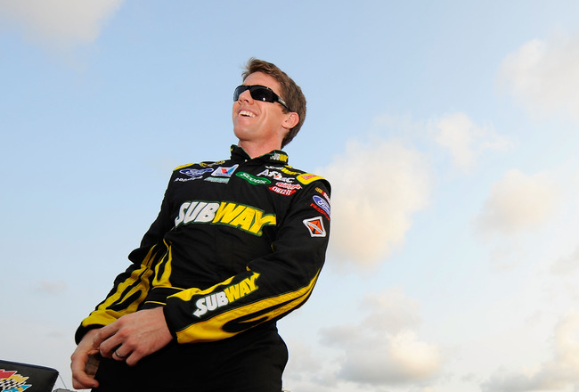 DAYTONA BEACH, FL - JULY 02:  Carl Edwards, driver of the #99 Subway Ford, walks across the stage during driver introductions before the NASCAR Sprint Cup Series Coke ZERO 400 Powered by Coca-Cola at Daytona International Speedway on July 2, 2011 in Dayto
