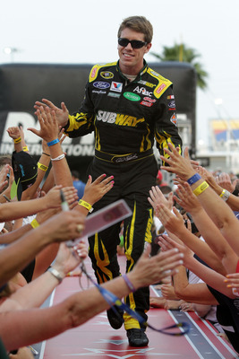 DAYTONA BEACH, FL - JULY 02:  Carl Edwards, driver of the #99 Subway Ford, greets fans during driver introductions prior to the start of the NASCAR Sprint Cup Series Coke ZERO 400 Powered by Coca-Cola at Daytona International Speedway on July 2, 2011 in D