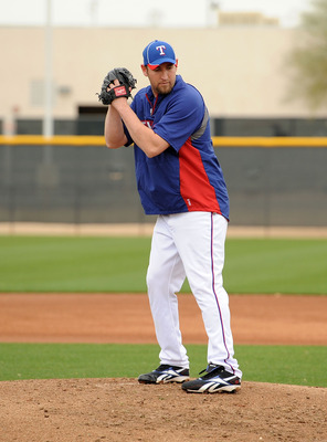 SURPRISE, AZ - FEBRUARY 18:  Brandon Webb #33 of the Texas Rangers gets ready to deliver a pitch at Surprise Stadium on February 18, 2011 in Surprise, Arizona.  (Photo by Norm Hall/Getty Images)