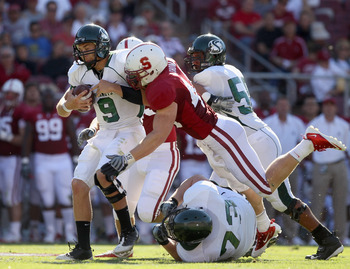 PALO ALTO, CA - SEPTEMBER 04:  McLeod Bethel-Thompson #9 of the Sacramento State Hornets is sacked by Chase Thomas #44 of the Stanford Cardinal at Stanford Stadium on September 4, 2010 in Palo Alto, California.  (Photo by Ezra Shaw/Getty Images)
