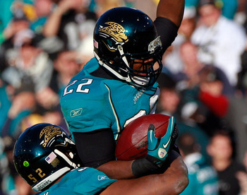 JACKSONVILLE, FL - DECEMBER 12:  Don Carey #22 of the Jacksonville Jaguars is lifted in to the air by Daryl Smith #52 following an interception against the Oakland Raiders during the game at EverBank Field on December 12, 2010 in Jacksonville, Florida.  (