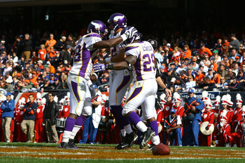 CHICAGO - OCTOBER 19:  (L-R) Adrian Peterson #28, Gus Frerotte #12 and Chester Taylor #29 of the Minnesota Vikings celebrate after Taylor scored a 1-yard rushing touchdown in the second quarter against the Chicago Bears at Soldier Field on October 19, 200