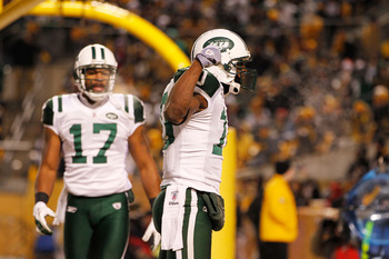 PITTSBURGH, PA - JANUARY 23:  Santonio Holmes #10 and Braylon Edwards #17 of the New York Jets celebrate after Holmes scored a third quarter touchdown against the Pittsburgh Steelers during the 2011 AFC Championship game at Heinz Field on January 23, 2011