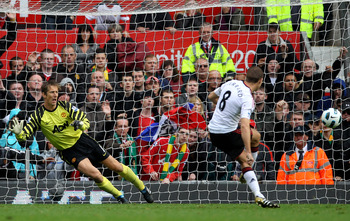 MANCHESTER, ENGLAND - SEPTEMBER 19:  Steven Gerrard of Liverpool scores his team's first goal from a penalty kick during the Barclays Premier League match between Manchester United and Liverpool at Old Trafford on September 19, 2010 in Manchester, England