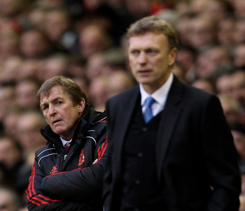 LIVERPOOL, ENGLAND - JANUARY 16:  Liverpool Manager Kenny Dalglish and Everton Manager David Moyes (R) look on during the Barclays Premier League match between Liverpool and Everton at Anfield on January 16, 2011 in Liverpool, England.  (Photo by Alex Liv