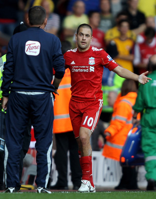 LIVERPOOL, ENGLAND - AUGUST 15:  Joe Cole of Liverpool reacts after being sent off during the Barclays Premier League match between Liverpool and Arsenal at Anfield on August 15, 2010 in Liverpool, England. (Photo by Clive Brunskill/Getty Images)