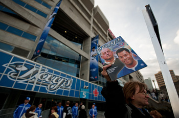 TORONTO,CANADA - APRIL 1:  Opening day programs are for sale outside the Rogers Centre prior to the home opener for the Toronto Blue Jays as they face the Minnesota Twins during their MLB game at the Rogers Centre April 1, 2011 in Toronto, Ontario, Canada