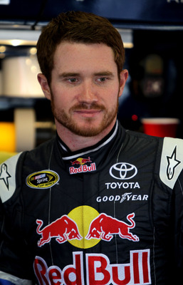DAYTONA BEACH, FL - JUNE 30:  Brian Vickers, driver of the #83 Red Bull Toyota, looks on in the garage during practice for the NASCAR Sprint Cup Series COKE ZERO 400 Powered by Coca-Cola at Daytona International Speedway on June 30, 2011 in Daytona Beach,
