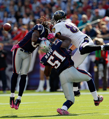 FOXBORO, MA - OCTOBER 17: Brandon Meriweather #31 of the New England Patriots collides with Todd Heap #86 of the Baltimore Ravens after Heap was hit by Jerod Mayo #51, also of the Patriots at Gillette Stadium on October 17, 2010 in Foxboro, Massachusetts.