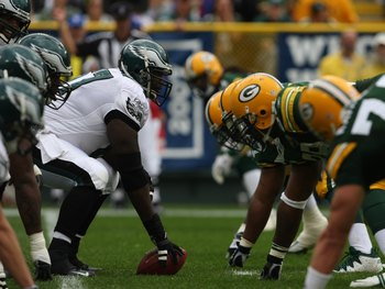 GREEN BAY, WI - SEPTEMBER 09: Center Jamaal Jackson #67 of the Philadelphia Eagles prepares to snap the ball against the Green Bay Packer defense on September 9, 2007 at Lambeau Field in Green Bay, Wisconsin. The Packers defeated the Eagles 16-13. (Photo
