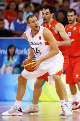 BEIJING - AUGUST 14: Dirk Nowitzki #14 of Germany holds the ball as Jorge Garbajosa #15 of Spain plays defence during the Men's Preliminary Round Group B  basketball game at the Olympic Basketball Gymnasium during day 6 of the Beijing 2008 Olympic Games o