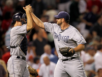 BOSTON, MA  - JUNE 21:  Heath Bell #21 and Nick Hundley #4 of the San Diego Padres celebrate in the ninth inning after a 5-4 win against the Boston Red Sox at Fenway Park on June 21, 2011 in Boston, Massachusetts.  (Photo by Jim Rogash/Getty Images)