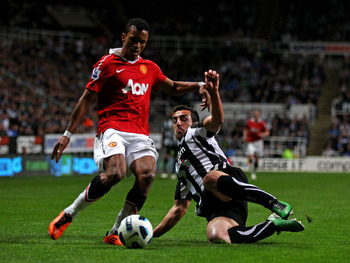 NEWCASTLE UPON TYNE, ENGLAND - APRIL 19:  Jose Enrique of Newcastle United challenges Nani of Manchester United during the Barclays Premier League match between Newcastle United and Manchester United at St James' Park on April 19, 2011 in Newcastle, Engla
