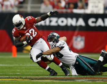 GLENDALE, AZ - JANUARY 18:  Running back Edgerrin James #32 of the Arizona Cardinals is tackled by safety Brian Dawkins #20 of the Philadelphia Eagles in the second quarter during the NFC championship game on January 18, 2009 at University of Phoenix Stad