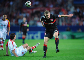 SEVILLE, SPAIN - NOVEMBER 04:  Pavel Pogrebnyak (R) of VfB Stuttgart is tackled by Sebastien Squilaci of Sevilla during the UEFA Champions League Group G match between Sevilla and VfB Stuttgart at the Sanchez Pizjuan stadium on November 4, 2009 in Seville