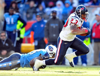 NASHVILLE, TN - DECEMBER 19:  Arian Foster #23 of the Houston Texans runs against the Tennessee Titans  at LP Field on December 19, 2010 in Nashville, Tennessee. The Titans defeated the Texans, 31-17.  (Photo by Grant Halverson/Getty Images)