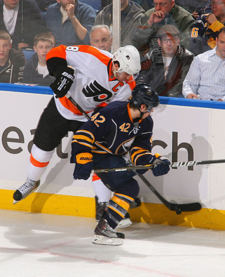 BUFFALO, NY - APRIL 18: Nathan Gerbe #42 of the Buffalo Sabres battles for puck control with Mike Richards #18 of the Philadelphia Flyers in Game Three of the Eastern Conference Quarterfinals during the 2011 NHL Stanley Cup Playoffs at HSBC Arena at HSBC