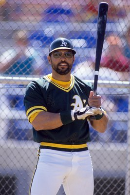 1987:  Reggie Jackson #44 of the Oakland Athletics bats during a game in the 1987 season. (Photo by Otto Greule Jr/Getty Images)