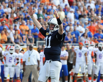 TAMPA, FL - JANUARY 1:  Quarterback Matt McGloin #11 of the Penn State Nittany Lions celebrates a touchdown pass against the Florida Gators January 1, 2011 in the 25th Outback Bowl at Raymond James Stadium in Tampa, Florida.  (Photo by Al Messerschmidt/Ge