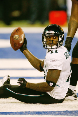 INDIANAPOLIS, IN - DECEMBER 19: Mike Sims-Walker #11 of the Jacksonville Jaguars holds up the football after scoring a touchdown against the Indianapolis Colts at Lucas Oil Stadium on December 19, 2010 in Indianapolis, Indiana. The Colts defeated the Jagu