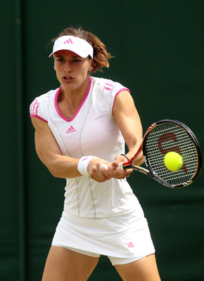 LONDON, ENGLAND - JUNE 24:  Andrea Petkovic of Germany returns a shot during her third round match against Ksenia Pervak of Russia on Day Five of the Wimbledon Lawn Tennis Championships at the All England Lawn Tennis and Croquet Club on June 24, 2011 in L