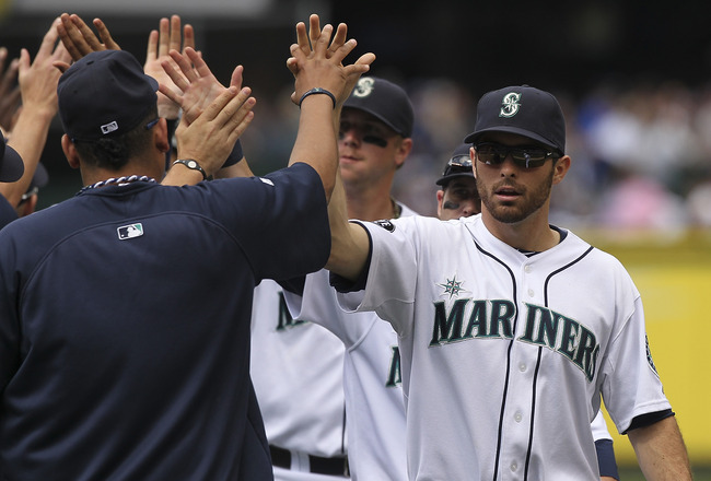 SEATTLE - JULY 03:  Second baseman Dustin Ackley #13 of the Seattle Mariners is congratulated by Felix Hernandez after defeating the San Diego Padres 3-1 at Safeco Field on July 3, 2011 in Seattle, Washington. (Photo by Otto Greule Jr/Getty Images)