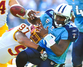 NASHVILLE, TN - NOVEMBER 21:  Lorenzo Alexander #97 of the Washington Redskins forces a fumble by quarterback Vince Young #10 of the Tennessee Titans during the first half at LP Field on November 21, 2010 in Nashville, Tennessee.  (Photo by Grant Halverso