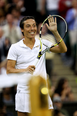LONDON, ENGLAND - JUNE 20:  Francesca Schiavone of Italy celebrates winning her first round match against Jelena Dokic of Australia on Day One of the Wimbledon Lawn Tennis Championships at the All England Lawn Tennis and Croquet Club on June 20, 2011 in L