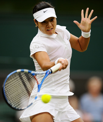 LONDON, ENGLAND - JUNE 23:  Na Li of China returns a shot during her second round match against Sabine Lisicki of Germany on Day Four of the Wimbledon Lawn Tennis Championships at the All England Lawn Tennis and Croquet Club on June 23, 2011 in London, En