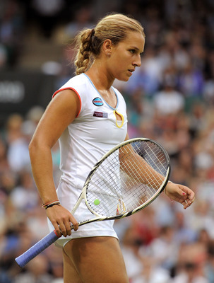 LONDON, ENGLAND - JUNE 28:  Dominika Cibulkova of Slovakia reacts to a play during her quarterfinal round match against Maria Sharapova of Russia on Day Eight of the Wimbledon Lawn Tennis Championships at the All England Lawn Tennis and Croquet Club on Ju